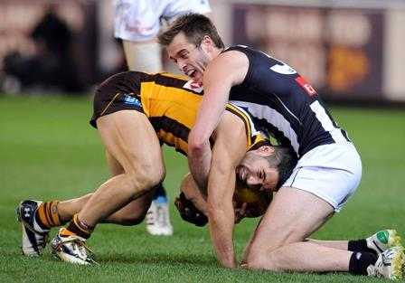 Alan Toovey of Collingwood tackles Paul Puopolo of Hawthorn in the first preliminary final of the 2011 AFL season. (AAP Image/Joe Castro)