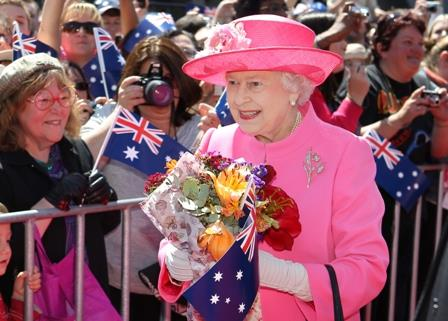 Queen Elizabeth II receives flowers from a welcoming crowd at Federation Square, Melbourne, Wednesday, Oct 26, 2011. The Queen and Duke of Edinburgh are on a 10 day visit to Australia. (AAP Image/Alex Coppel)
