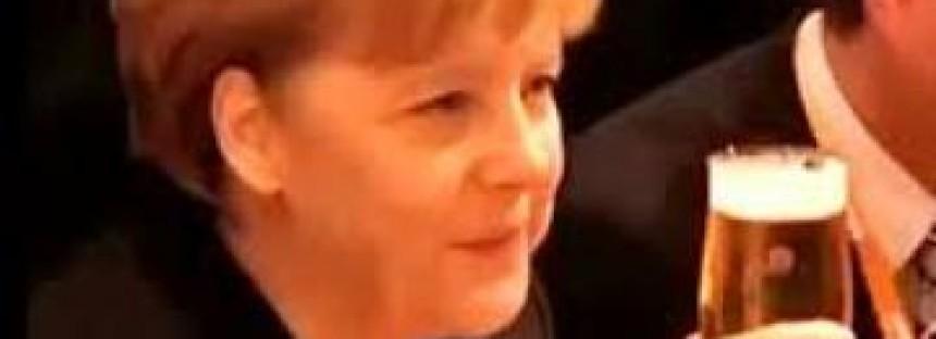 Waiter spills beers down Merkel's back