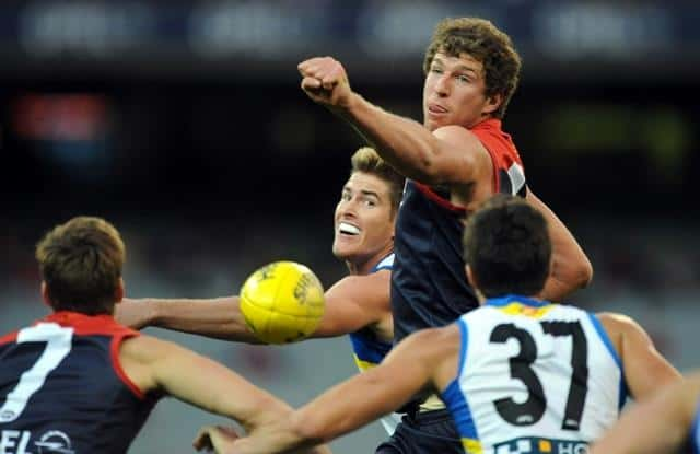 Jake Spencer of Melbourne and Zac Smith of the Gold Coast Suns contest for the ball, during the round 7 AFL match between Melbourne and Gold Coast Suns in Melbourne, Sunday, May 12, 2013. (AAP Image/Joe Castro)