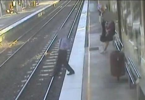 Australian man falls on train tracksAustralian man falls on train tracks