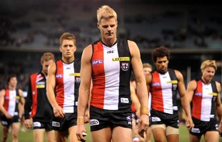 A disappointed St Kilda team walk off the ground after their Round 11 AFL match between the St Kilda Saints and the West Coast Eagles at Etihad Stadium in Melbourne, Sunday, June 9, 2013. West Coast Eagles defeated St Kilda by 12.12.(84) to 11.14.(80). (AAP Image/Joe Castro)