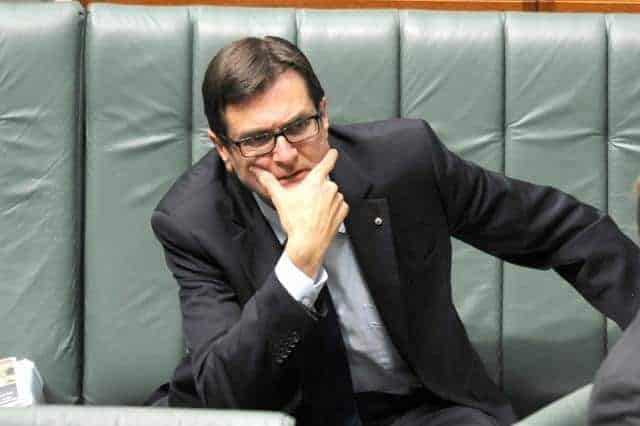 Climate Change Minister Greg Combet listens during House of Representatives question time at Parliament House Canberra, Wednesday, June 5, 2013. (AAP Image/Alan Porritt) NO ARCHIVING