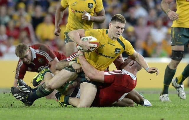 Wallabies player James O'Connor (centre) is tackled during the first Test match between the Wallabies and the British and Irish Lions at Suncorp Stadium in Brisbane, Saturday, June 22, 2013. (AAP Image/Dan Peled) NO ARCHIVING, EDITORIAL USE ONLY