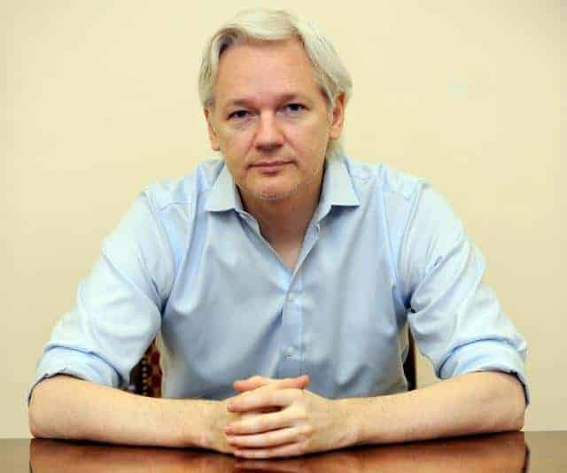 Julian Assange speaks to the media inside the Ecuadorian Embassy in London ahead of the first anniversary of his arrival there on 19th June, 2012. PRESS ASSOCIATION Photo. Picture date: Friday June 14, 2013. WikiLeaks