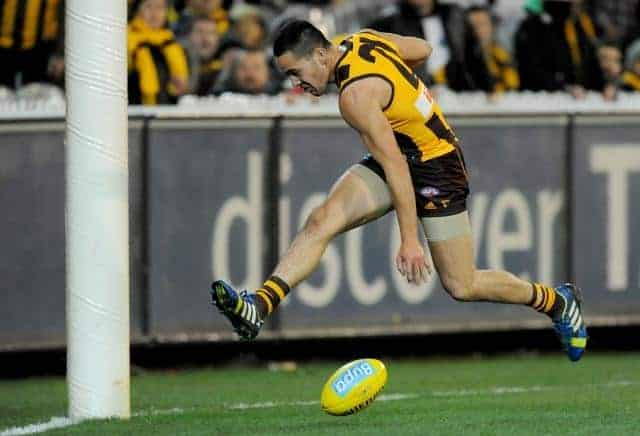 Shane Savage of Hawthorn attempts a goal, during the Round 21 AFL match between the Collingwood Magpies and the Hawthorn Hawks at the MCG in Melbourne, Friday, Aug. 16, 2013. Hawthorn defeated Collingwood by 18.11.(119) to 12.12.(84). (AAP Image/Joe Castr