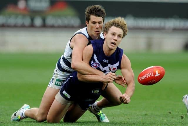Andrew Mackie of Geelong tackles Chris Mayne of Fremantle, during the AFL qualifying final between the Geelong Cats and Fremantle Dockers at Simonds stadium in Geelong, Saturday, Sep. 7, 2013. (AAP Image/Joe Castro) NO ARCHIVING, EDITORIAL USE ONLY