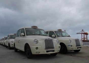 A supplied image obtained Monday, Sep. 16, 2013 of London-style cabs, painted white and imported from China, seen at Fremantle port in Perth. The cabs are set to be trialled in Australia in a bid to convince local authorities around the country to purchas
