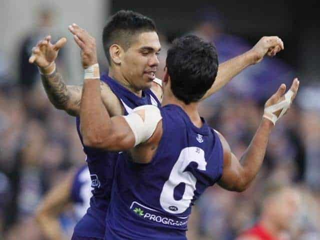 Michael Walters and Danyle Pearce of Fremantle celebrate a goal against the Swans on their way to this Saturday's AFL Grand Final. (AAP Image/Theron Kirkman)