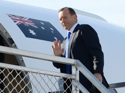 Tony Abbott boarding a flight to Jakarta to discuss asylum seeker issues