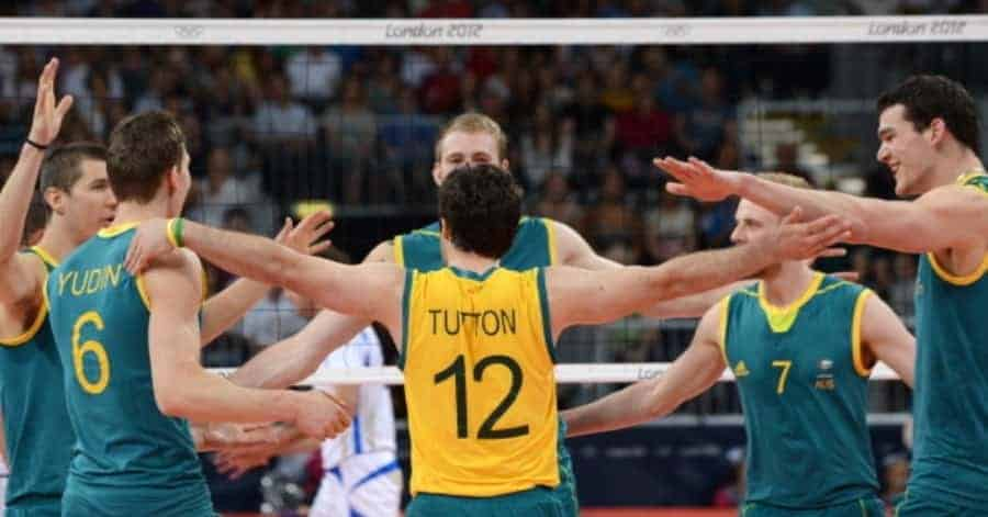 IMAGE: Australia's volleyball players led by Aden Tutton (C) celebrate winning a point during the 2012 London Olympic Games. (KIRILL KUDRYAVTSEV/AFP/GettyImages)