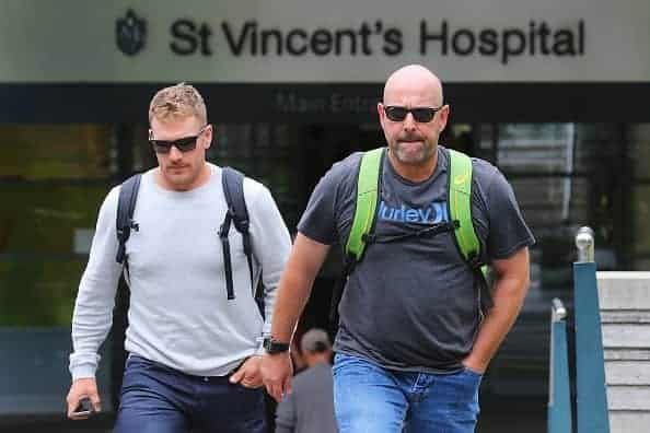 IMAGE: Australian cricket coach Darren Lehmann (R) and player Aaron Finch (L) leave St Vincent's Hospital on Thursday after visiting Phil Hughes. (Photo by Joosep Martinson/Getty Images)