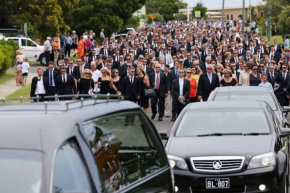 PHILLIP HUGHES FUNERAL: The procession along the streets of Macksville after the service (Photo by Chris Hyde/Getty Images)