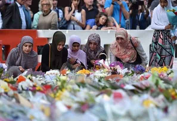 AYDNEY SIEGE MEMORIAL: Young Muslim women lay flowers at a makeshift shrine near the scene of a fatal siege in the heart of Sydney's financial district.(Peter Parks/AFP/Getty Images)
