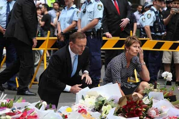 SYDNEY SIEGE: Prime Minister Tony Abbott and wife Margie pay their respects at the Martin Place memorial site.