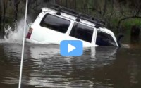 One bloke and his Land Cruiser tackle flooded river [VIDEO]