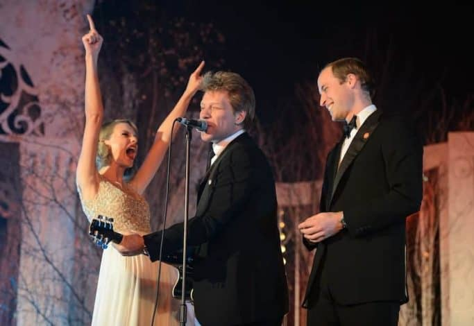 Taylor Swift, Jon Bon Jovi and Prince William, Duke of Cambridge sing on stage at the Centrepoint Gala Dinner