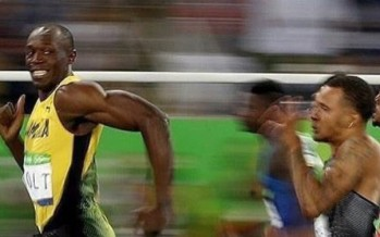 Olympic meme: Usain Bolt's outrageous mid-race smile captured on Aussie's camera
