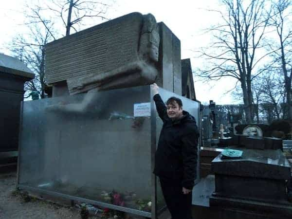 The Author at the tomb of Oscar Wilde in Paris.