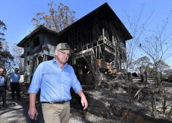 "Prime Minister Scott Morrison inspecting a burnt-out property in the Gold Coast hinterland in September 2019. Mr Morrison has offered ""thoughts and prayers"" to those affected by the fires. (Dave Hunt/AAP)"