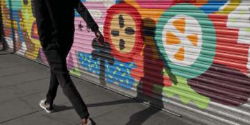 Man walking in Brixton, London. Photo: Adobe Stock