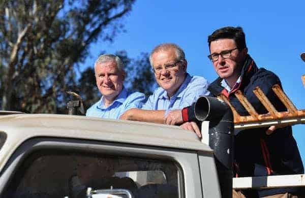 Nationals leader and Deputy Prime Minister, Michael McCormack (left) with Prime Minister Scott Morrison (centre). (Mick Tsikas/AAP/The Conversation)