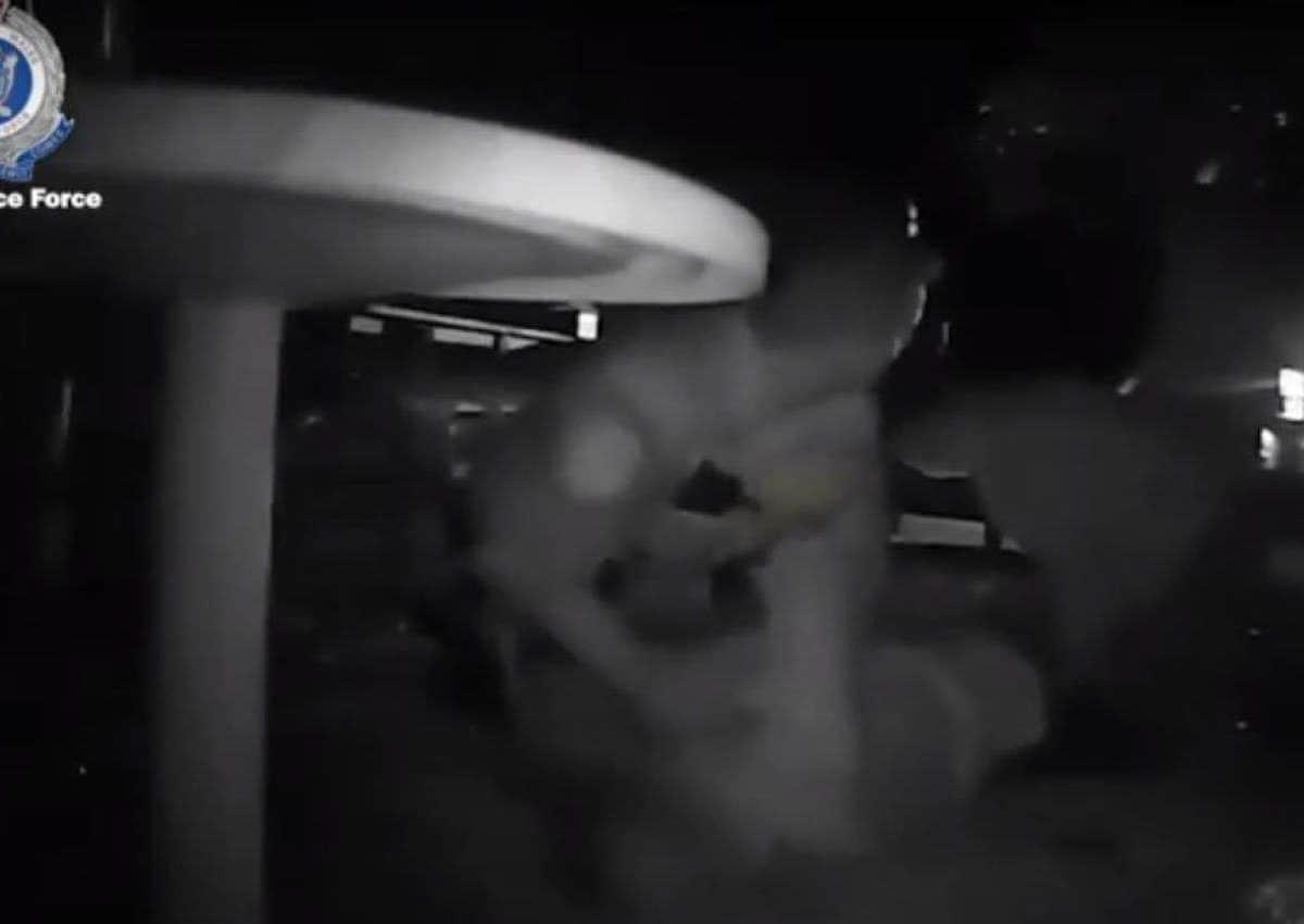 Police camera still from alleged assault video