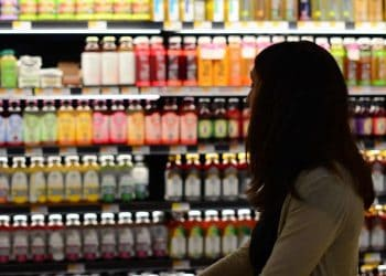 Woolworths restrictions lifted - woman shopping