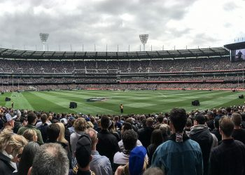 Fans at the MCG await the teams ahead of the 2018 Grand Final. Photo credit: Wikimedia Commons.