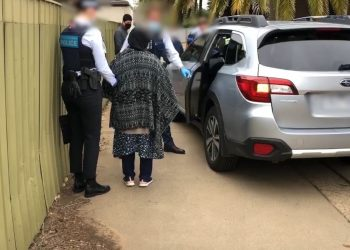 Alleged human traffickers being arrested in Shepparton. Photo credit: AFP
