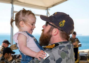 Lieutenant Commander Mitchell Thomas greets his daughter Emily after HMAS Sirius returned to Fleet Base West in WA. Photo credit: RAN