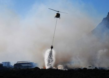 A file photo of a firefighting helicopter in action. Photo credit: Wikimedia Commons
