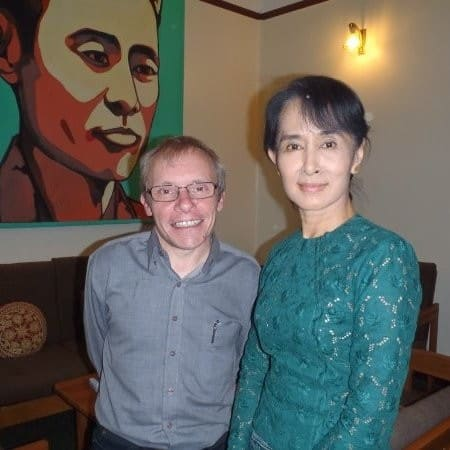 Professor Sean Turnell pictured with political leader and Nobel Peace Prize laurate, Aung San Suu Kyi. Photo credit: LinkedIn
