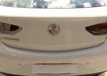 The car with its damaged tail light