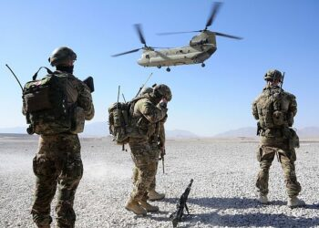 Australian soldiers prepare to board a US helicopter in Afghanistan in 2013. Photo credit Wikimedia Commons