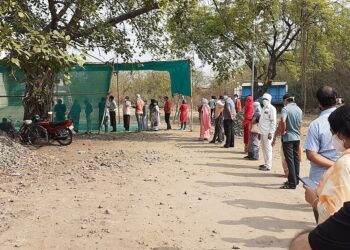 A covid vaccination queue in India earlier this month. Photo credit: Ganesh Dhamodkar via Wikimedia Commons