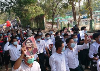 People in Myanmar protest against the military coup. Photo credit: Wikimedia Commons