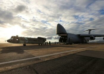 A new CH-47F Chinook heavy-lift helicopter is unloaded from a United Stated C-5 Galaxy at RAAF Base Townsville, Queensland. Photo credit: Trooper Lisa Sherman, ADF