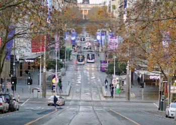 A near-deserted Melbourne CBD during lockdown. Photo credit: Michael J Fromholtz via Wikipedia
