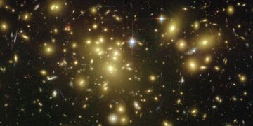 Strong gravitational lensing as observed by the Hubble Space Telescope in Abell 1689 indicates the presence of dark matter. Photo credit: NASA via Wikipedia